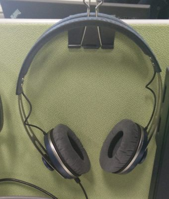 Bulldog clip providing a handy place to hang the headphones